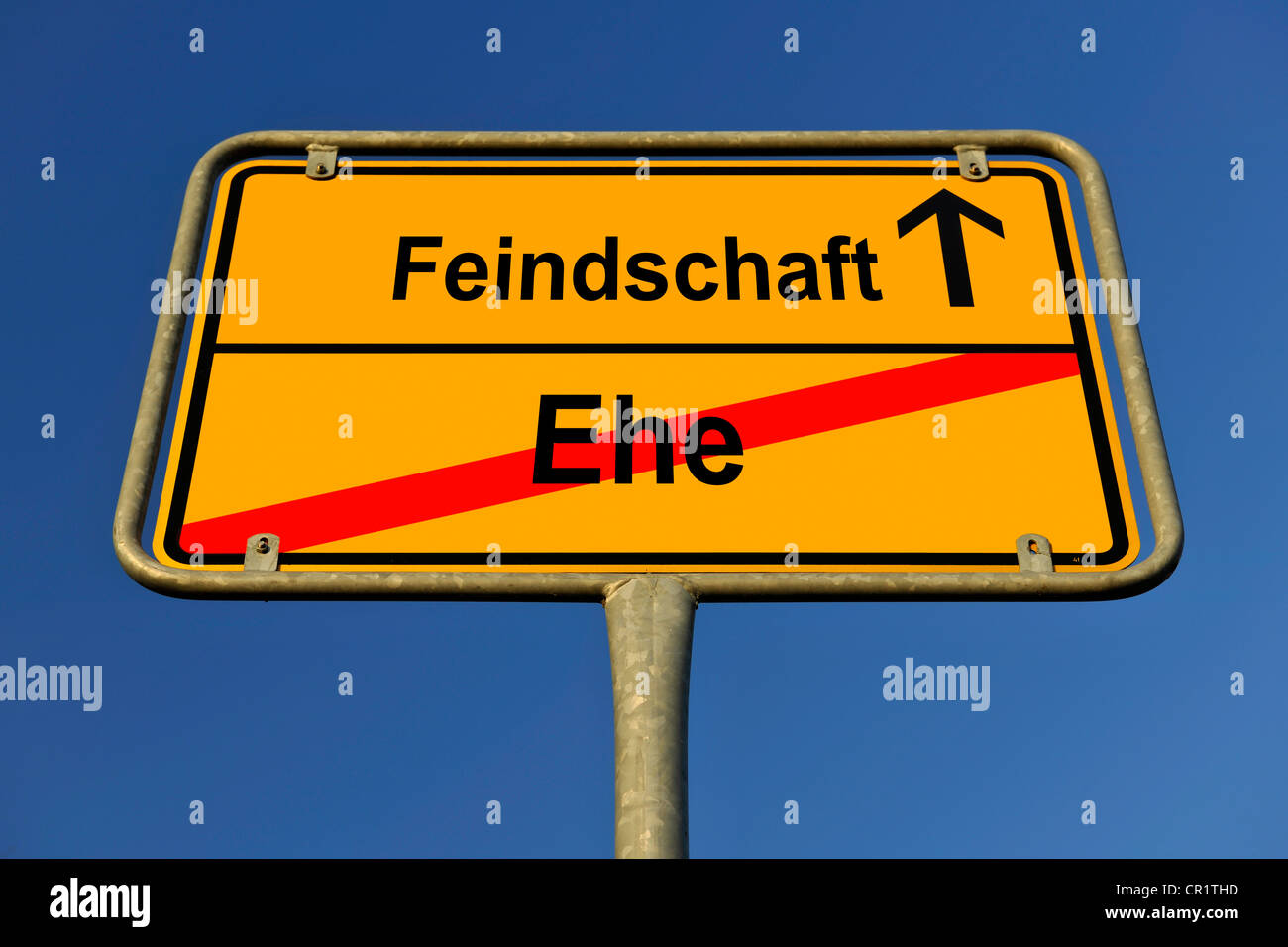 City limits sign with the words Feindschaft and Ehe, German for hostility and marriage, symbolic image for the end - Stock Image
