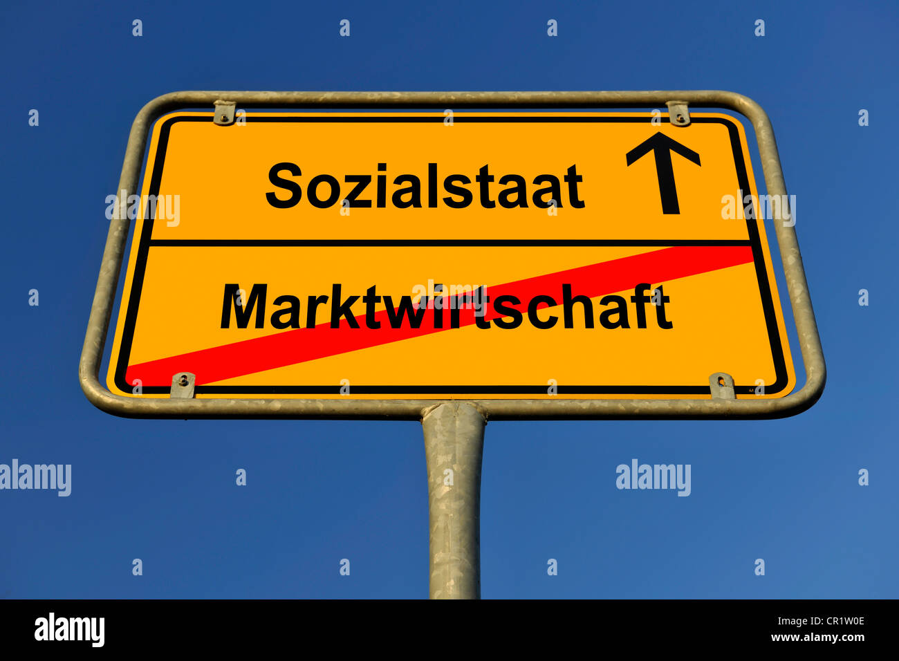 City limit sign, symbolic image for the way from a Marktwirtschaft to a Sozialstaat, German for going from a market - Stock Image