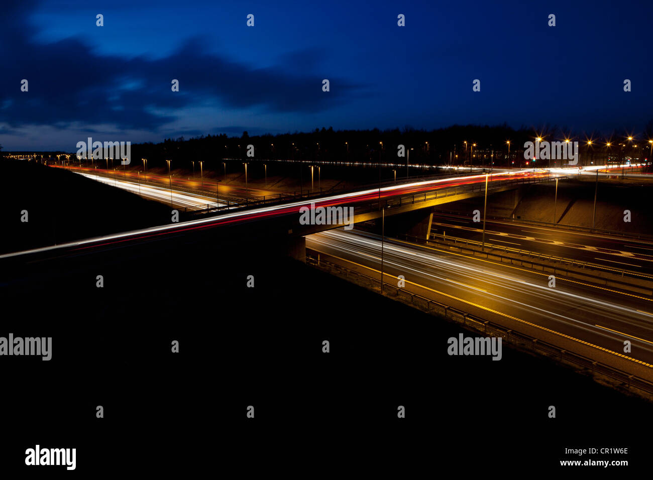 Time lapse view of traffic at night - Stock Image