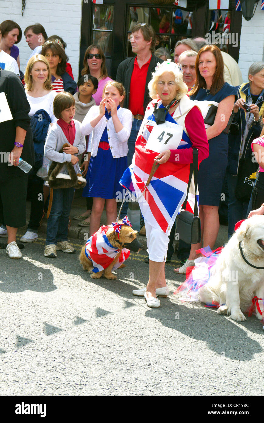 An old lady dressed in a Union Jack Flag with her dog in a competition during a Queens Diamond Jubilee Celebration - Stock Image