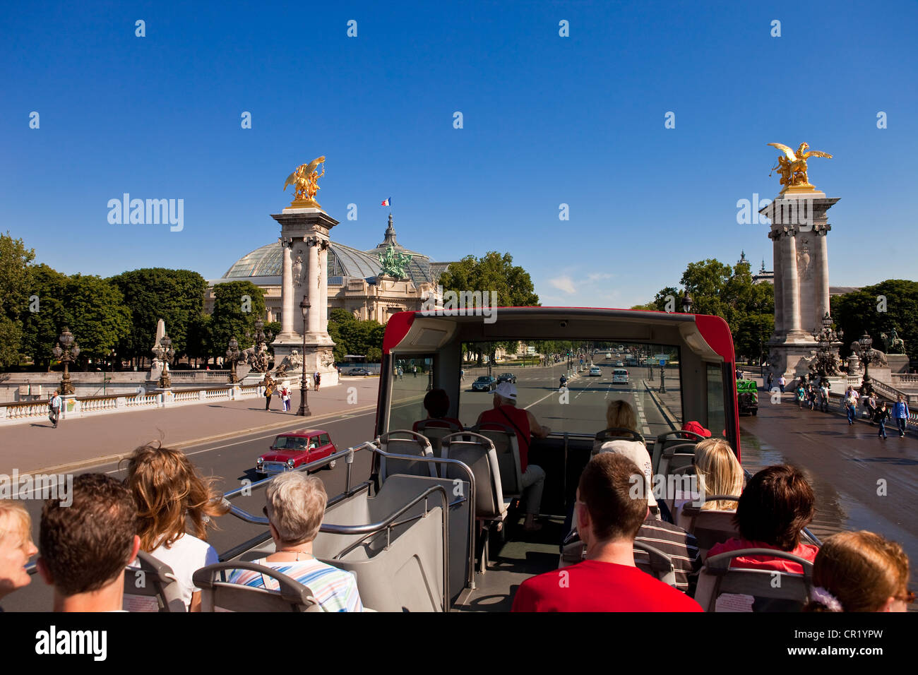 France, Paris, tourist trip on double decker bus, going over pont Alexandre III - Stock Image