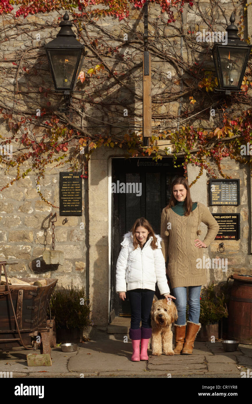 Family standing at historic building - Stock Image