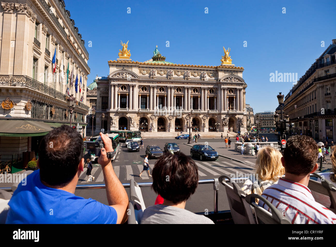 France, Paris, tourist trip on double decker bus, passing in front of Opera Garnier - Stock Image