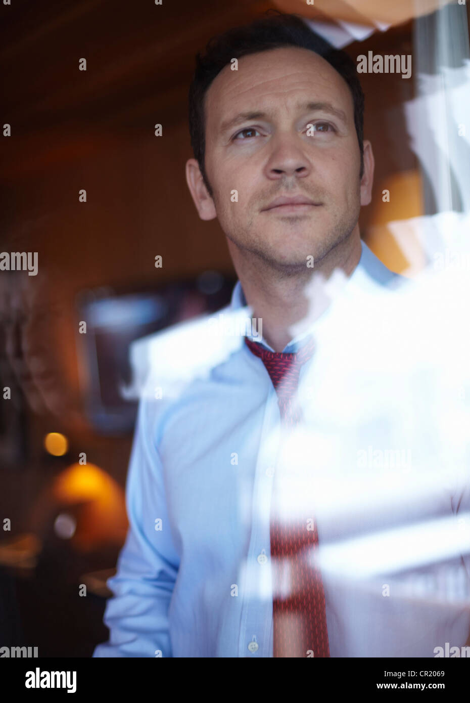 Businessman looking out window Stock Photo