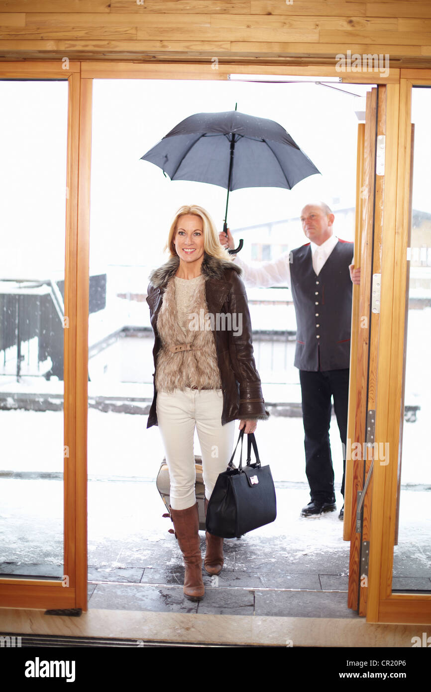 Couple walking through hotel front doors Stock Photo 48602350 Alamy