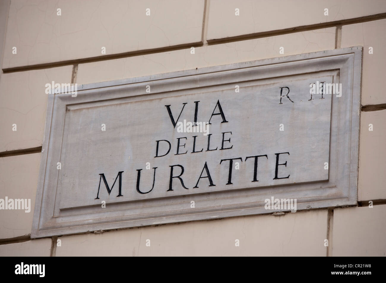 Via delle Muratte sign on wall - Stock Image