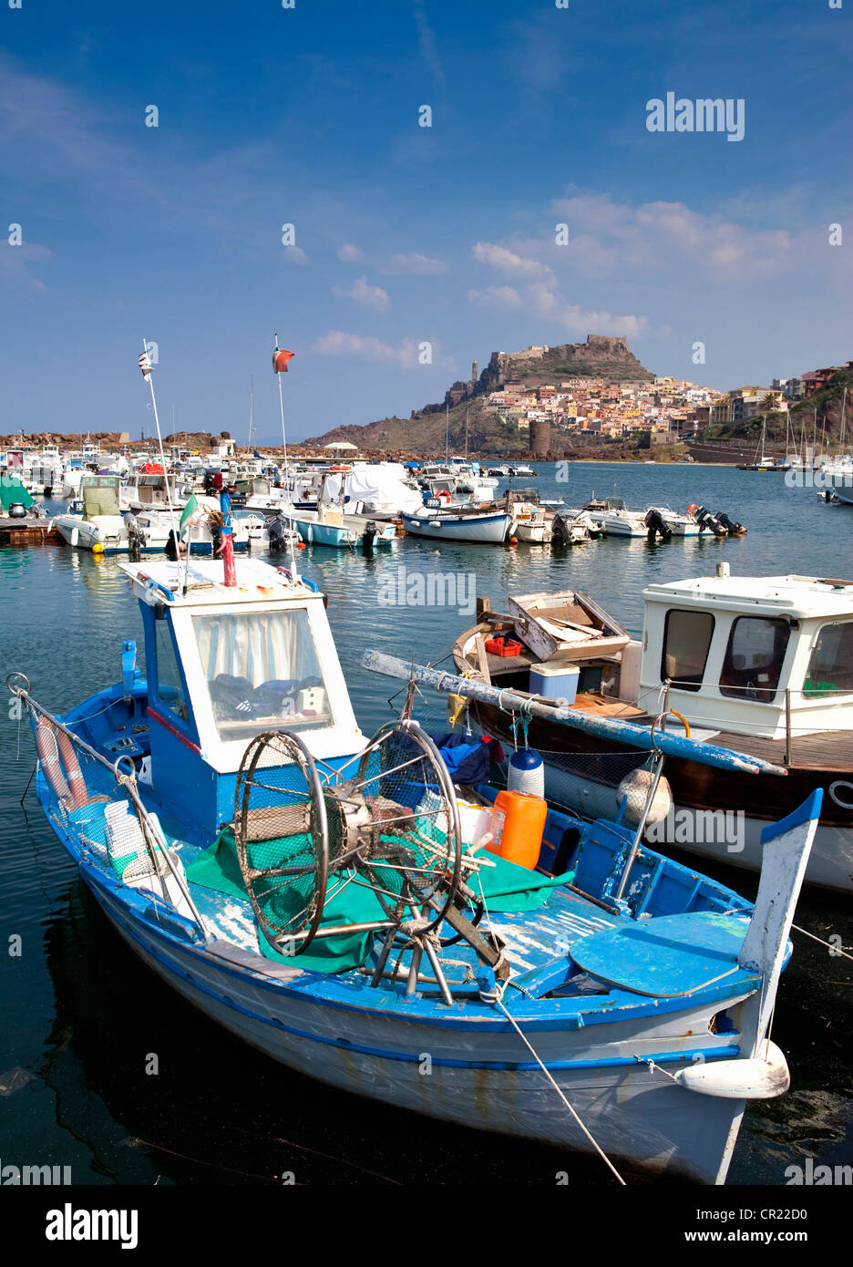 Fishing boats docked in pier - Stock Image