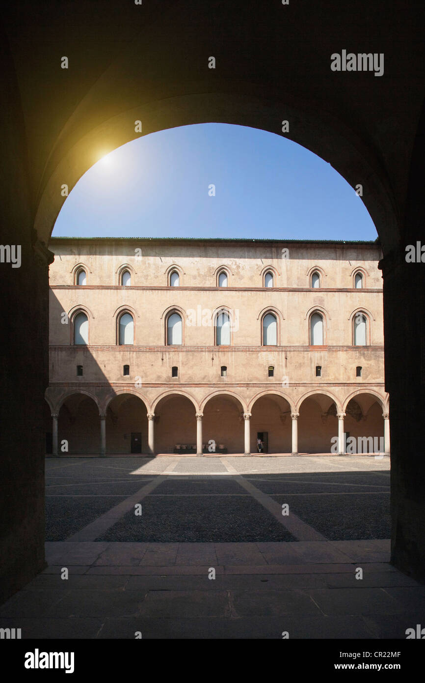 Archways in ornate courtyard Stock Photo