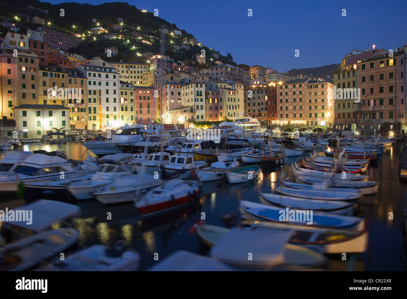 Boats docked in urban pier - Stock Image