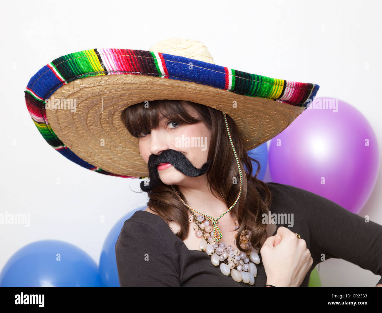 Studio Shot of young woman dressed up as Mexican - Stock Image