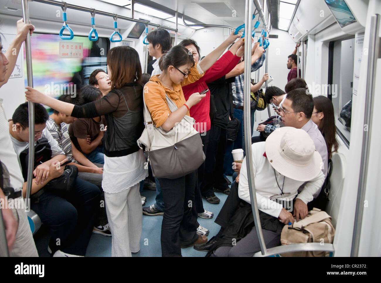 China: Beijing Subway passengers - Stock Image
