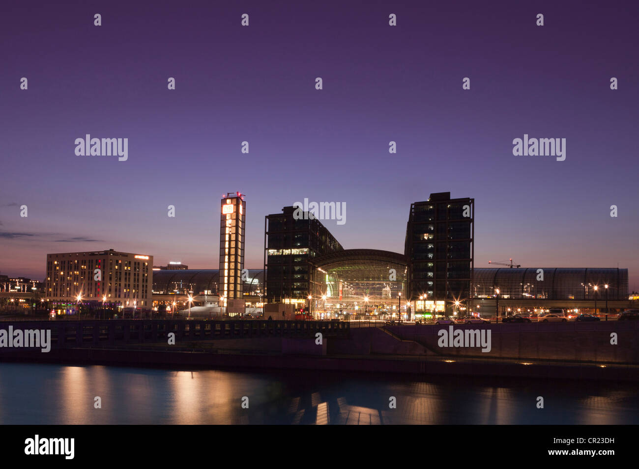 City skyline lit up at night - Stock Image