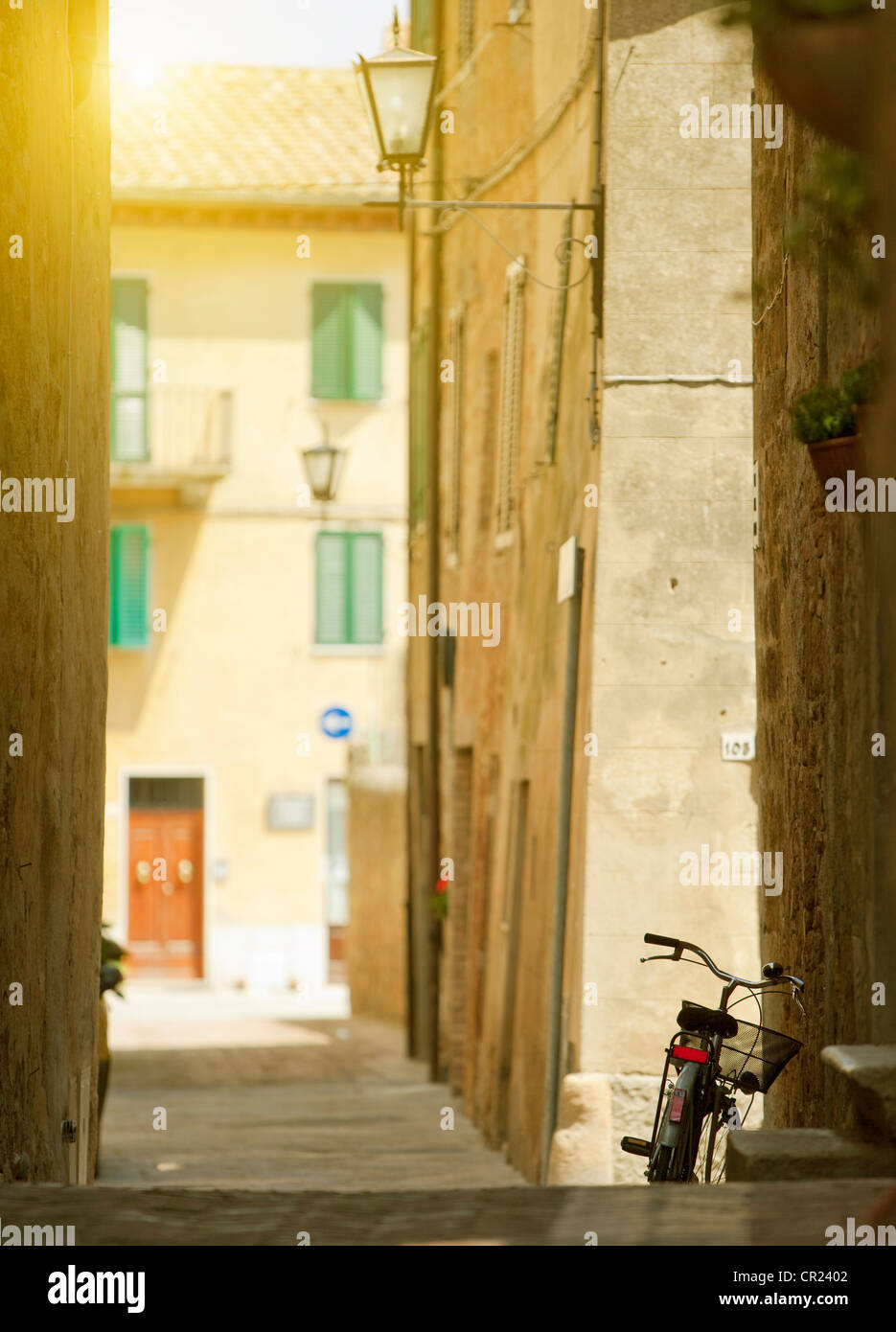 Bicycle parked in village alleyway - Stock Image