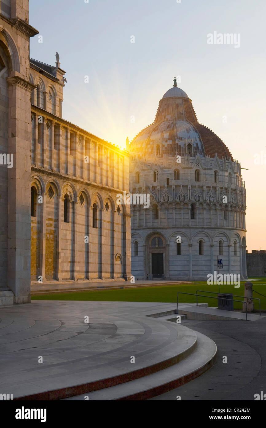 Sun shining over ornate buildings - Stock Image