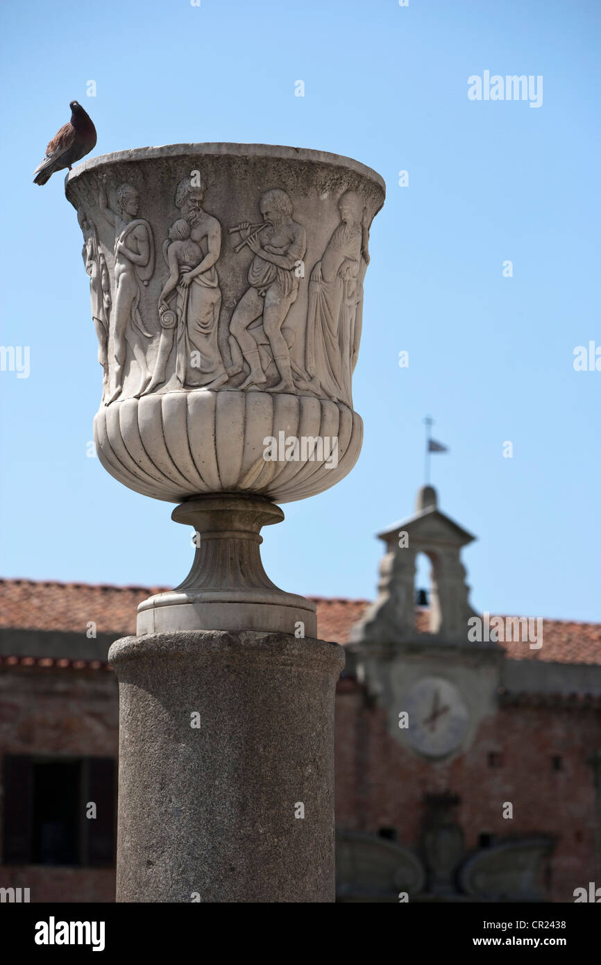 Pigeon perched on ornate statue - Stock Image