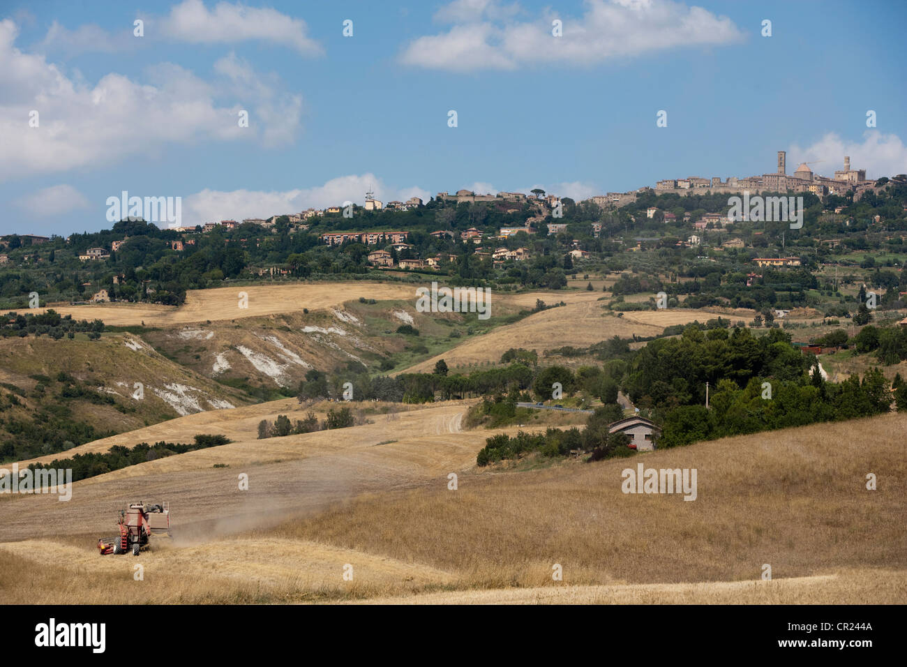 Machinery at work in crop fields - Stock Image