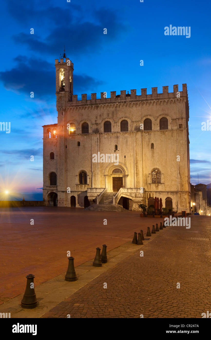 Building and tower lit up at night - Stock Image