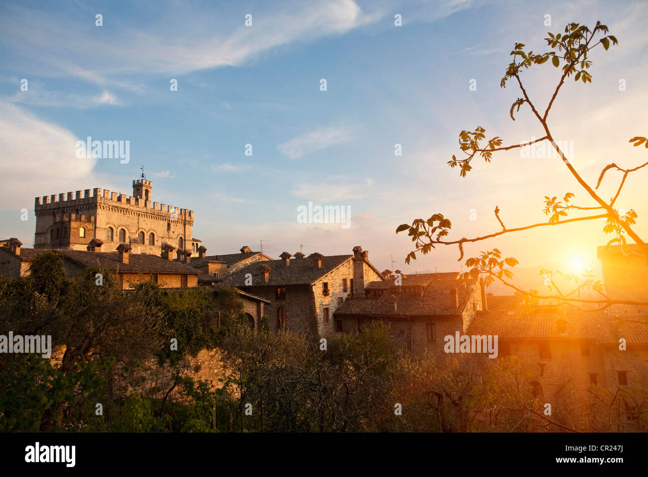 Sun shining on village houses - Stock Image