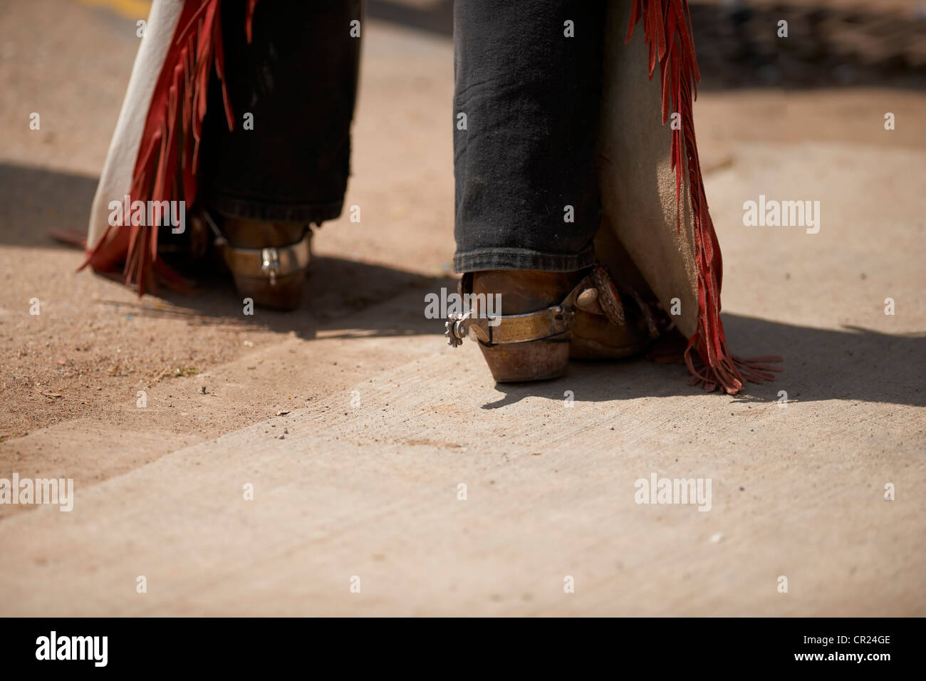 Cowboy boots, spurs, and chaps at the Calgary Stampede - Stock Image