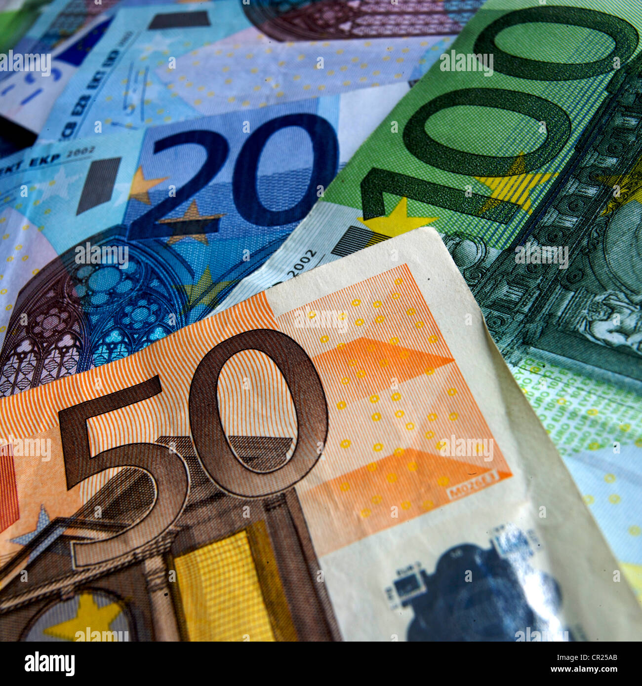 Euros - close up of a pile of different denomination Euro notes - Stock Image
