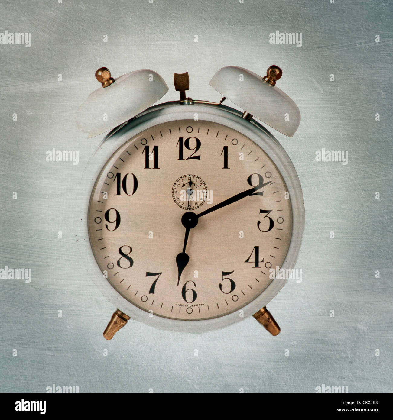 Old fashioned alarm clock. - Stock Image