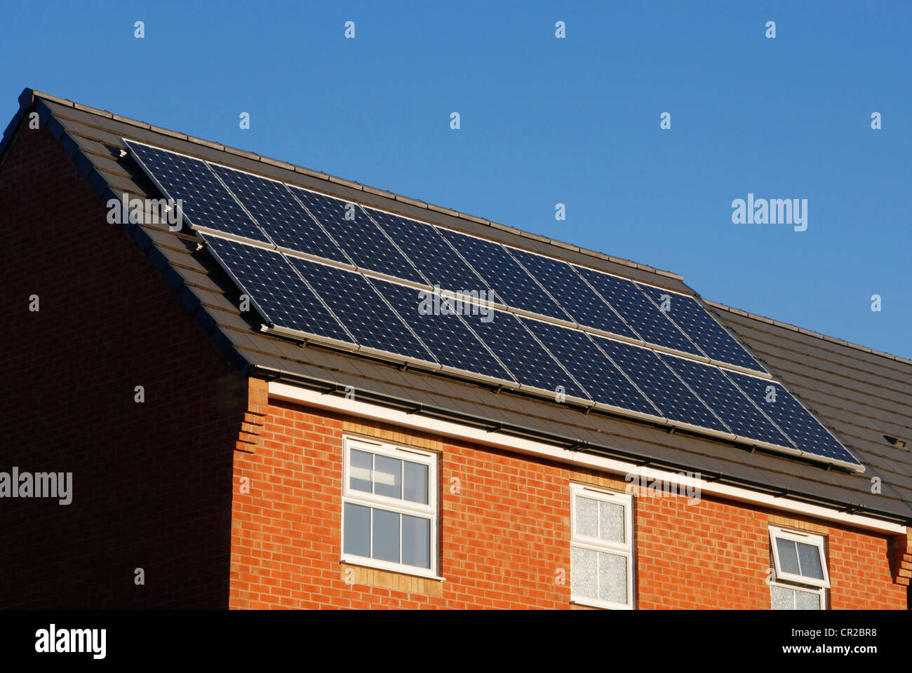 Modern house with solar power panels on the roof. - Stock Image