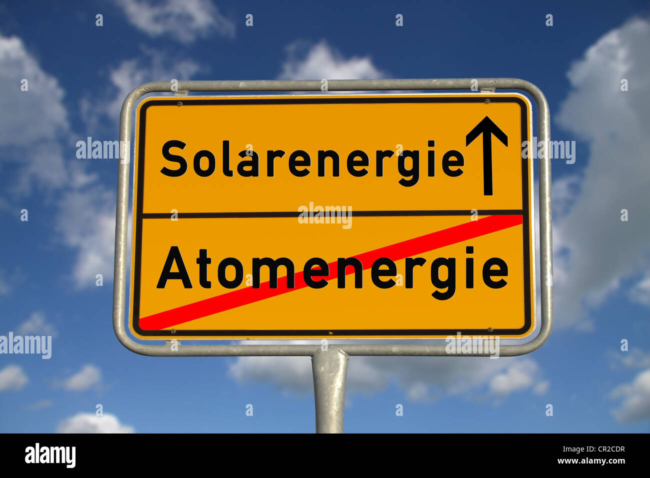 German road sign nuclear energy and solar energy with blue sky and white clouds - Stock Image