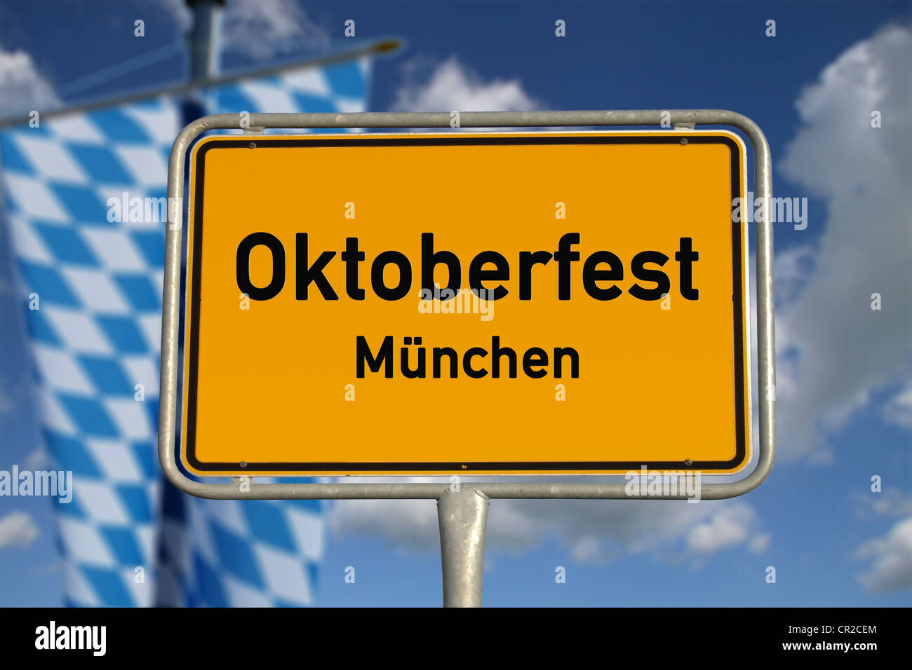German road sign Oktoberfest Munich, Bavaria with blue sky and white clouds - Stock Image