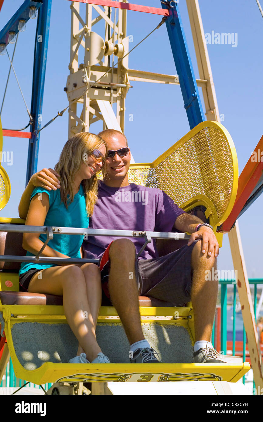 A Young Couple Enjoy A Ride On The Ferris Wheel That Is A Landmark Of Stock Photo Alamy
