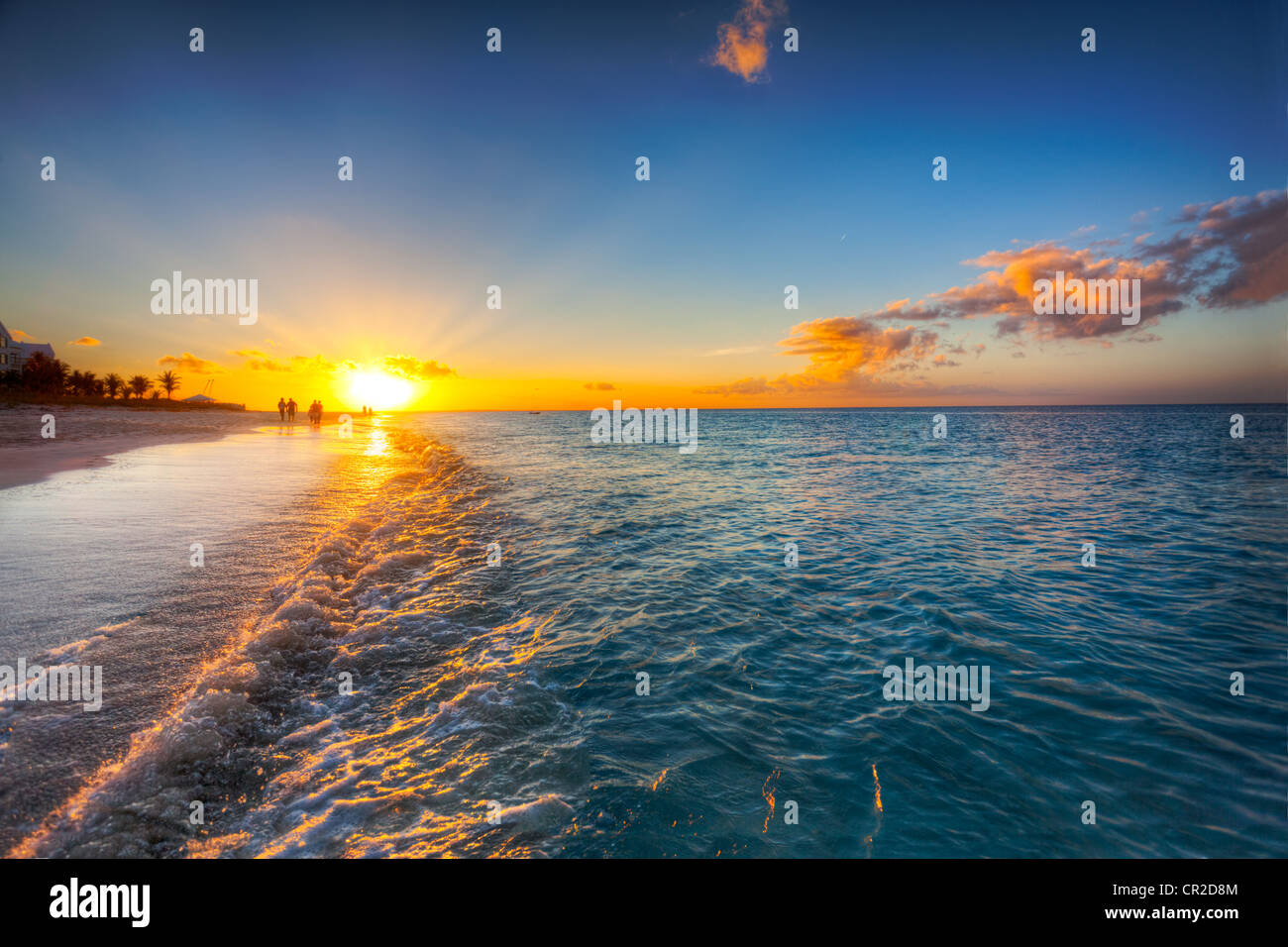 Grace Bay Beach, Turks & Caicos, with the setting sun at the horizon - Stock Image