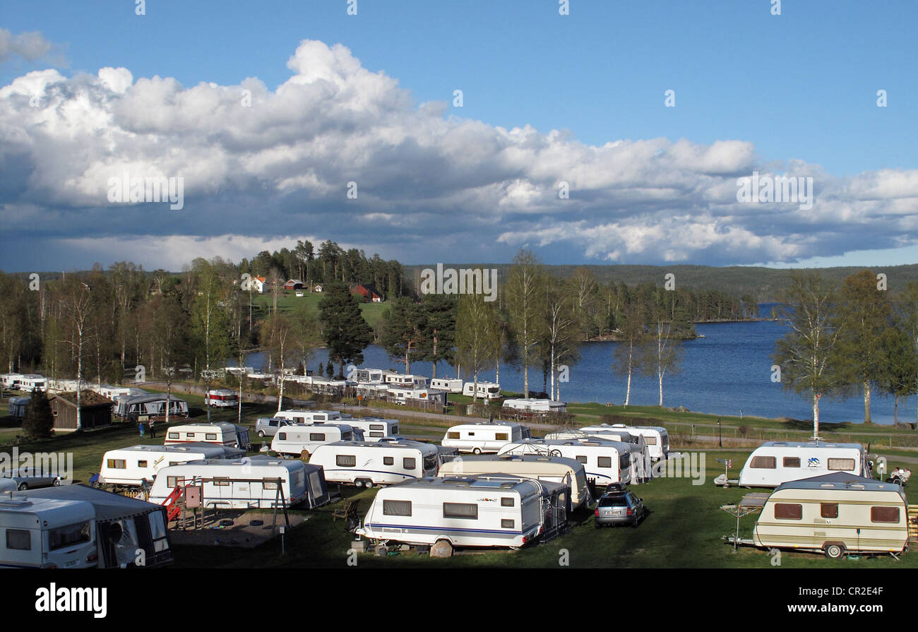 Travel trailers in Ekeby Camping site by Västra Silen lake, Årjäng, Värmland, Sweden - Stock Image