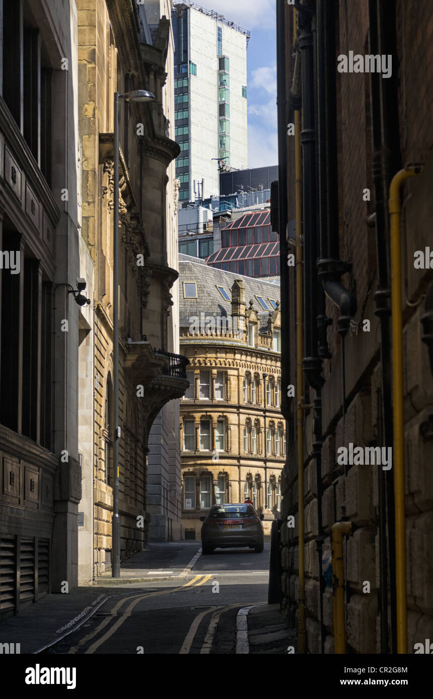 A view down Chancery Lane, Manchester with Elaborate Victorian building and the City Tower, Picadilly Gardens in - Stock Image