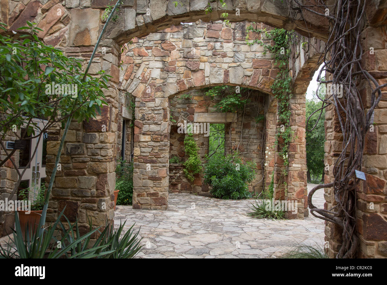 Stone arches covered in vines at the Ladybird Johnson wildflower ...
