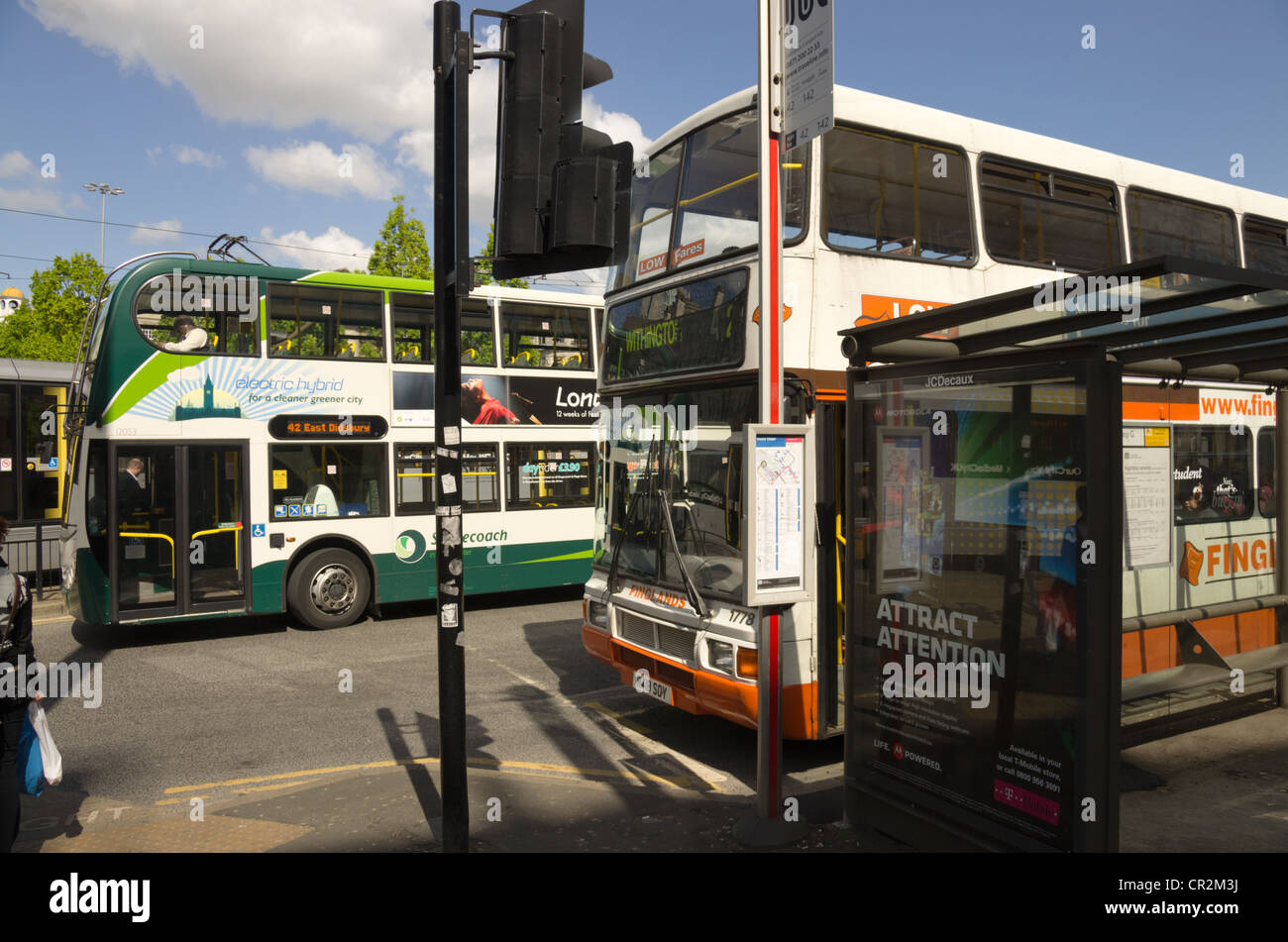 Transport interchange Picadilly Square Manchester with buses waiting - Stock Image