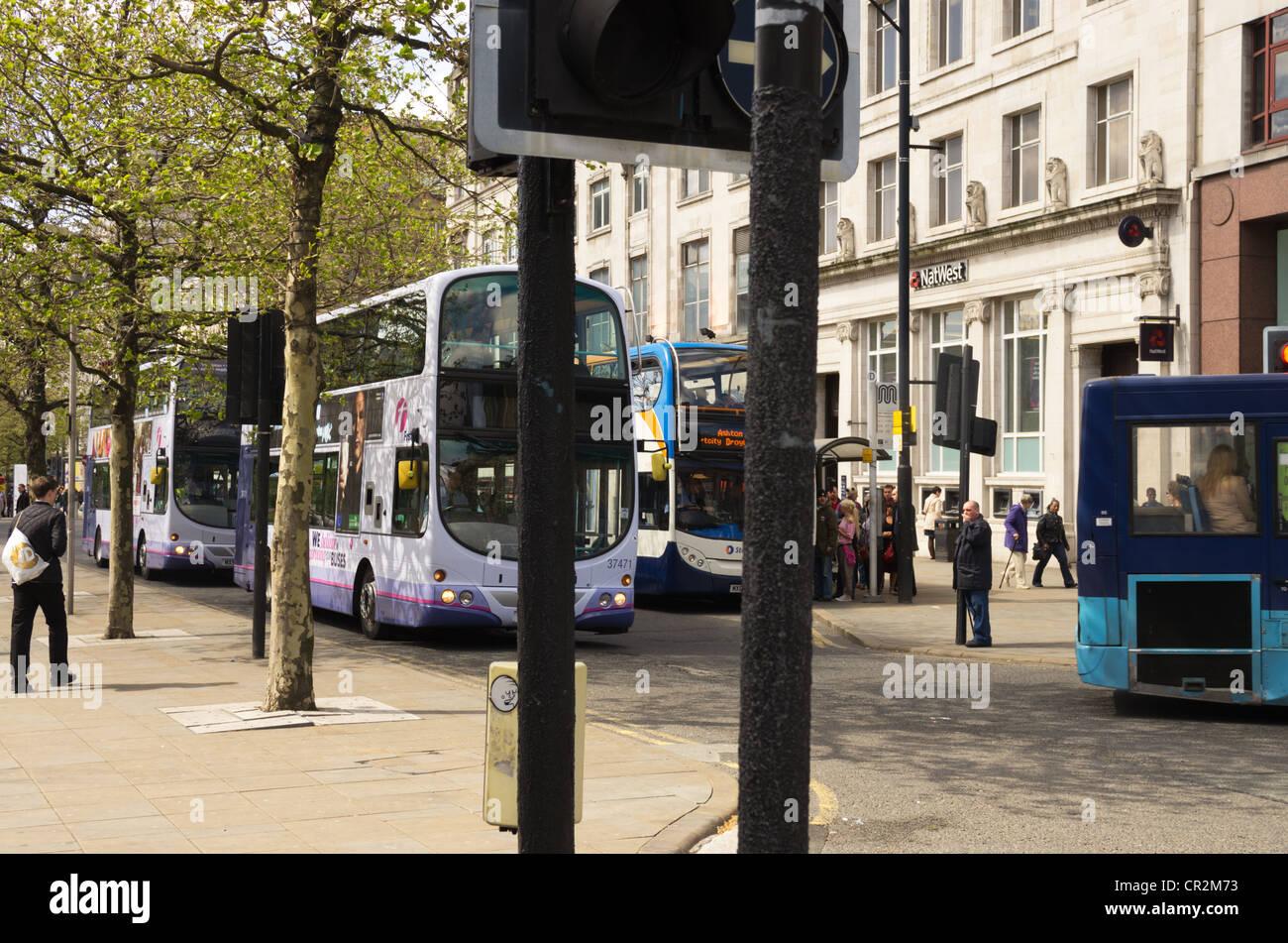 Buses at Traffic lights in Picadilly Square Manchester - Stock Image