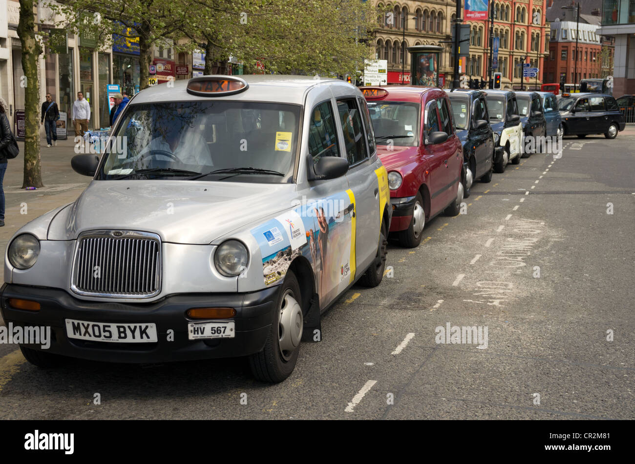A view of taxis Picadilly Square Manchester - Stock Image