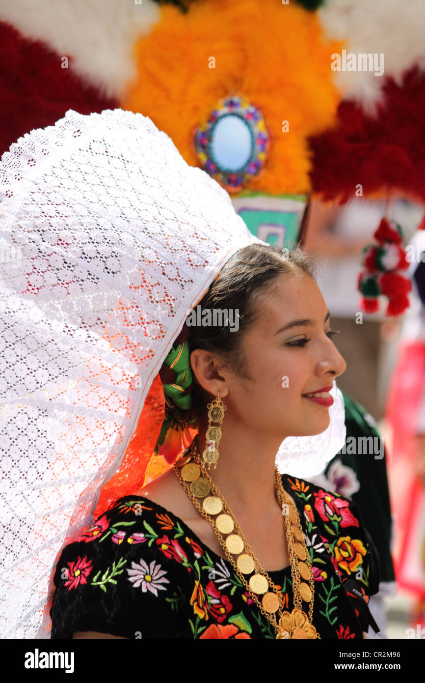 Mexican lady at festival with white lace headdress and traditional costume taken in Oaxaca city, Mexico - Stock Image