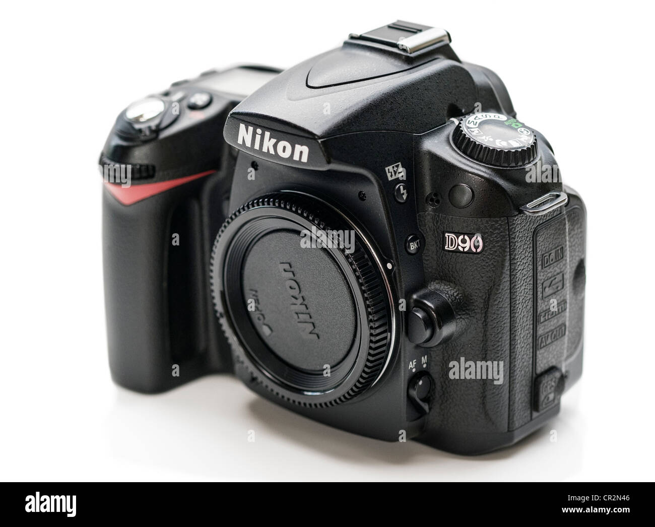 A used Nikon D90 DSLR Camera on a White Background Stock