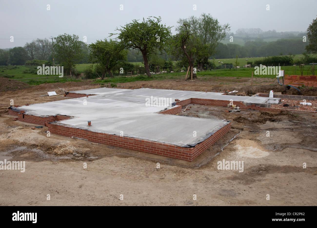 Finished concrete pour passive slab foundation Colemans Hill Farm Ecobuild Mickleton UK - Stock Image