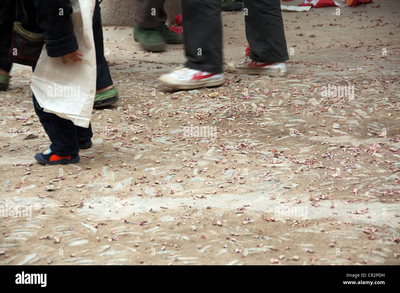 Used fireworks on the ground during a funeral rite, Zhaoxing Dong Village, Southern China Stock Photo