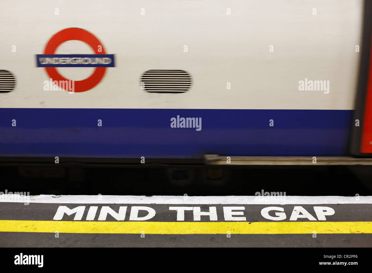 A 'Mind The Gap' sign on the platform at Kentish Town Underground Station, London. - Stock Image
