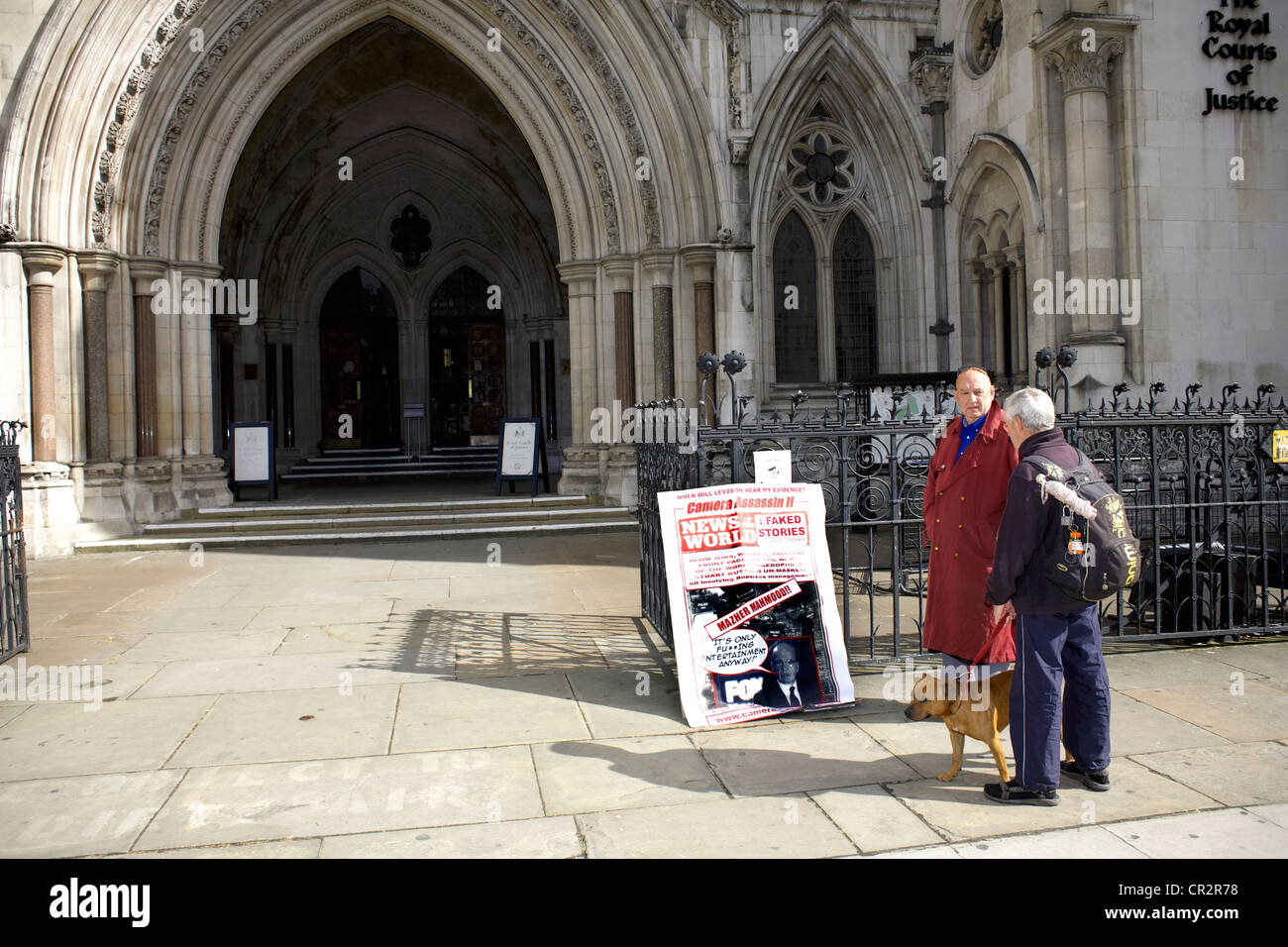 Former News of the World photographer Ian Cutler demonstrates during the Leveson Enquiry outside the Royal Courts - Stock Image