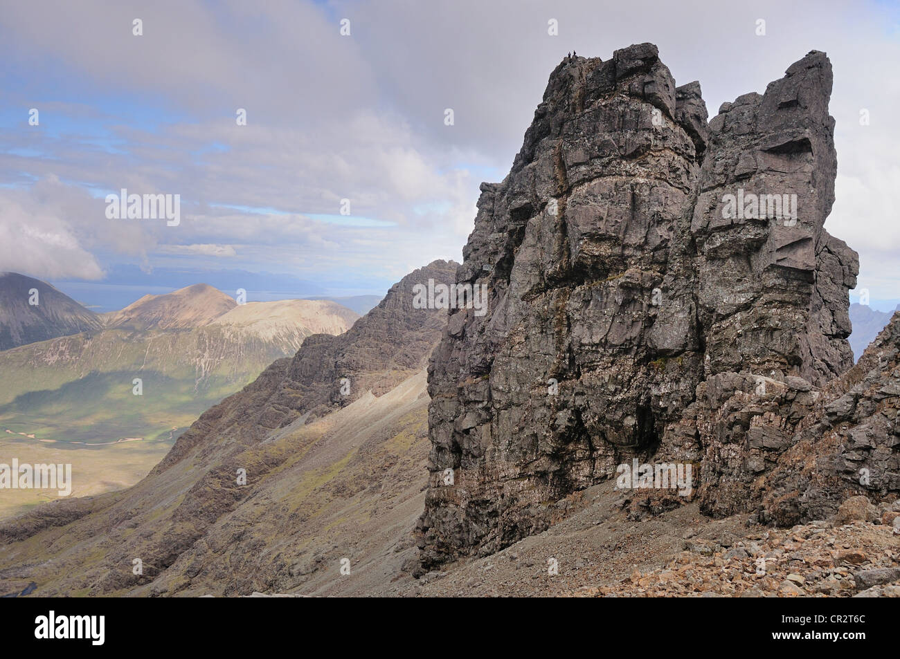 Climbers on the summit of Am Basteir, Black Cuillin, Isle of Skye, Scotland - Stock Image