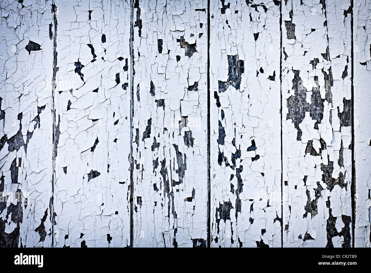 Background of old wood boards with peeling paint - Stock Image