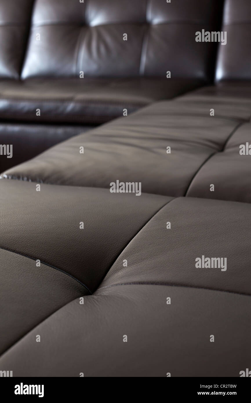 Closeup of luxurious expensive black leather couch - Stock Image
