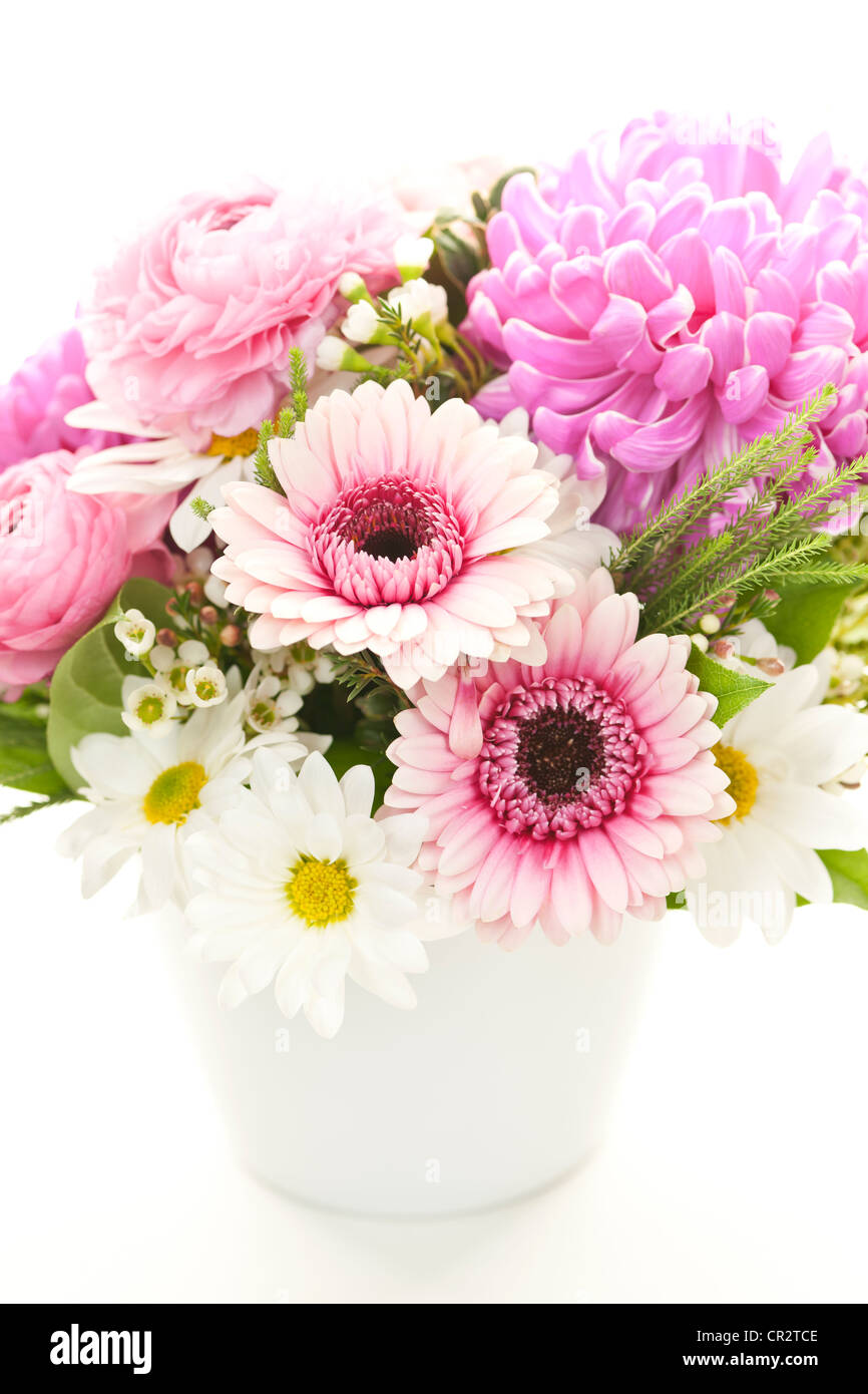 Bouquet of colorful flowers arranged in small vase - Stock Image