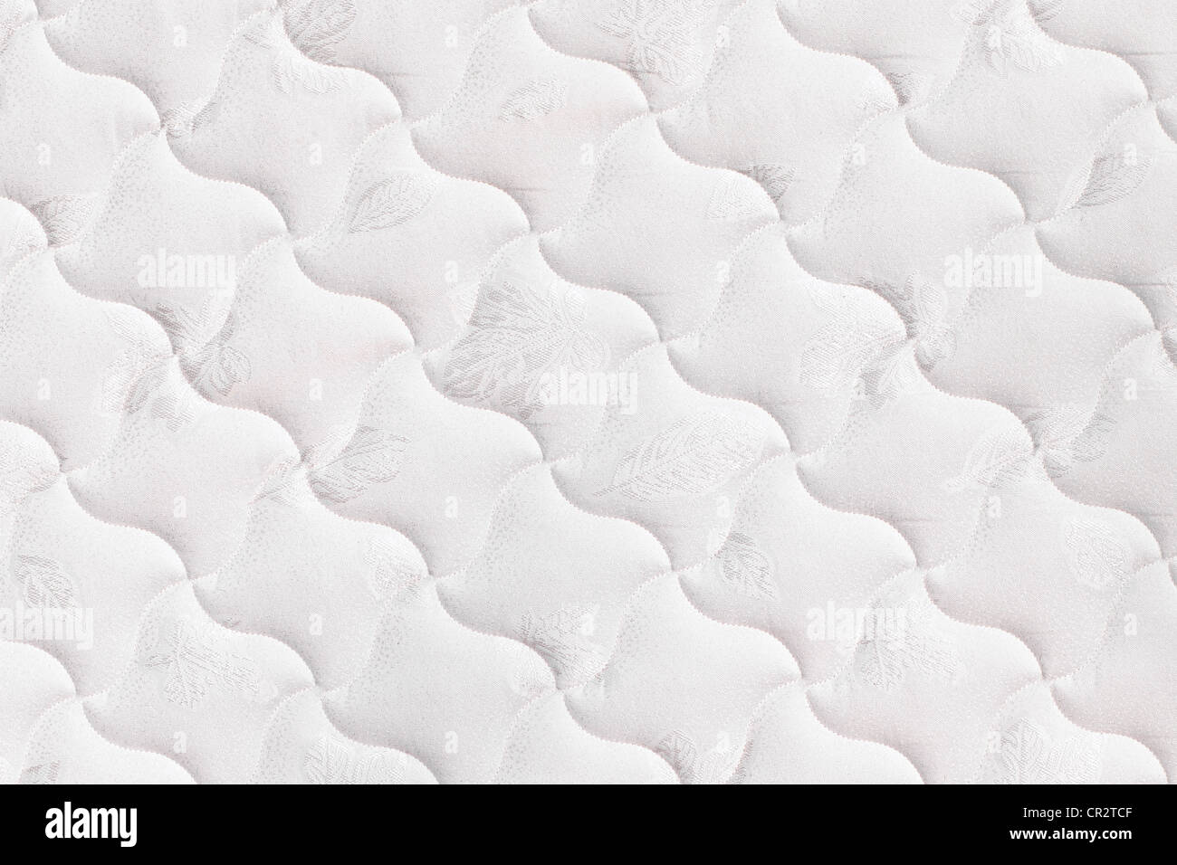 Background of soft comfortable quilted white mattress - Stock Image