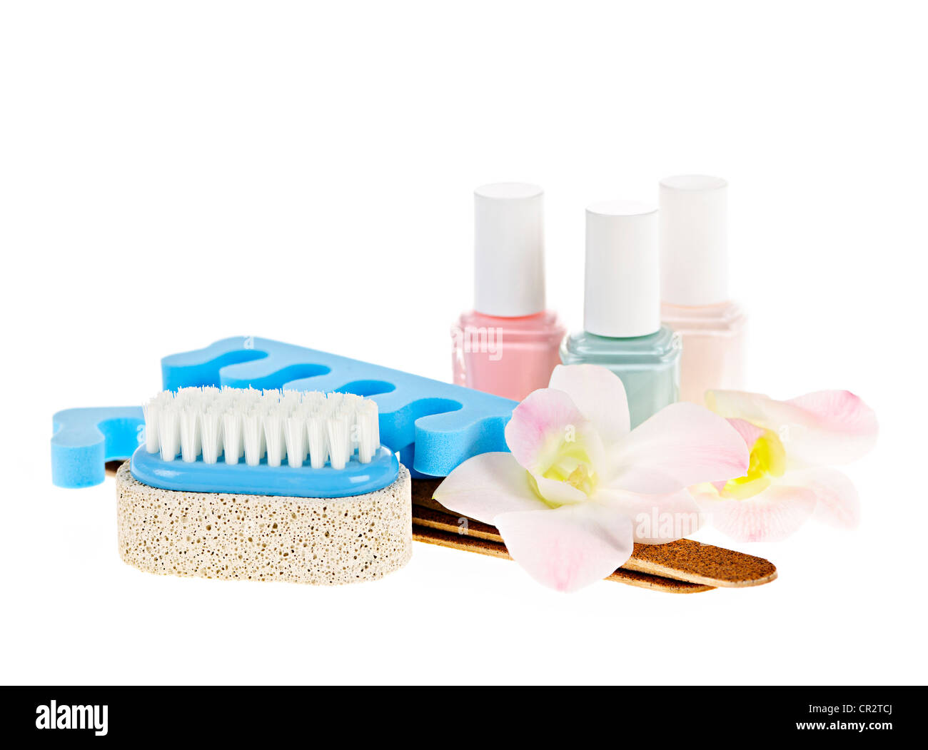 Pedicure accessories with nail polish on white background - Stock Image