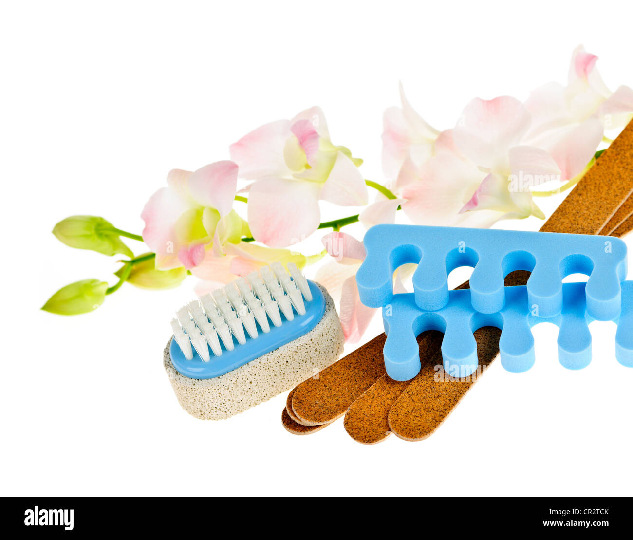 Pedicure accessories with orchid flowers on white background - Stock Image