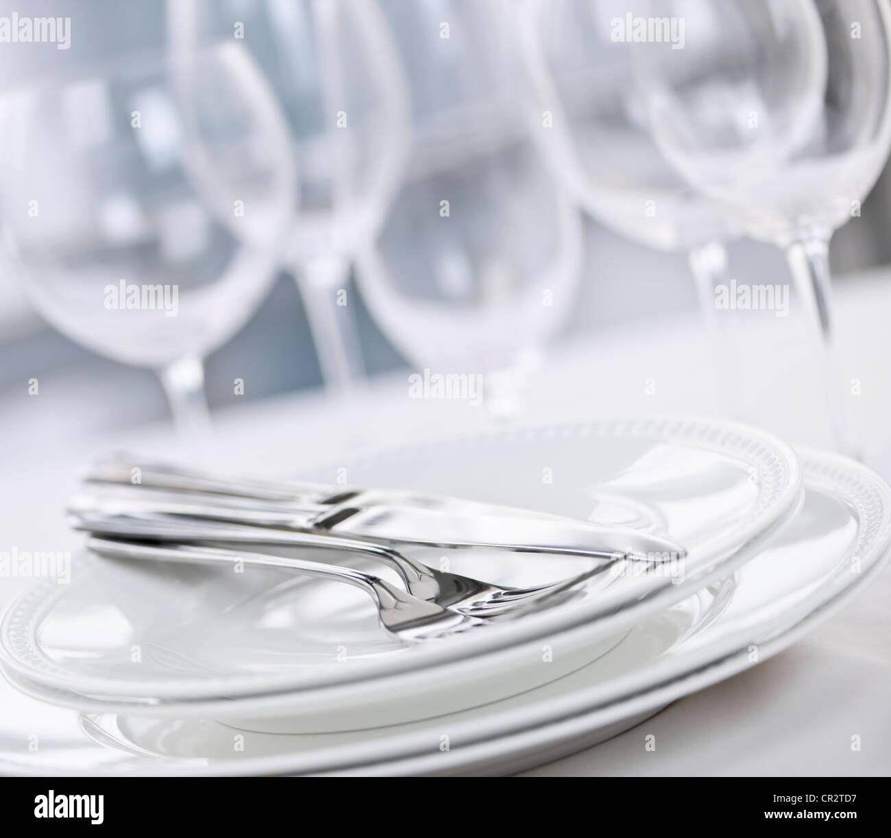 Elegant restaurant table setting with plates cutlery and stemware & Elegant restaurant table setting with plates cutlery and stemware ...